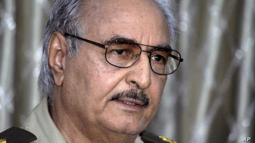 In this Saturday, May 17, 2014 photo, Libyan Gen. Khalifa Hifter addresses a press conference in Benghazi, Libya