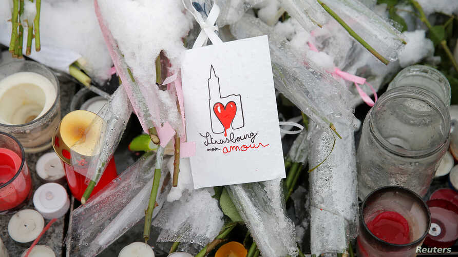 "A drawing representing Strasbourg's cathedral is seen at an improvised memorial in tribute to the victims of December 11 attack during a ceremony in Strasbourg, France, Dec. 16, 2018. The sign reads ""Strasbourg my love."""