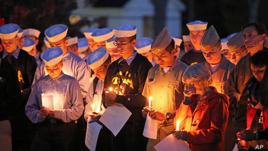 Maine Maritime Academy students bow their heads during a vigil of hope for the missing crew members of the U.S. container ship El Faro, Oct. 6, 2015, in Castine, Maine.