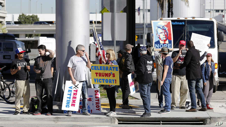 FILE - Supporters of President Donald Trump gather outside Tom Bradley International Terminal as protests against President Trump's executive order banning travel from seven Muslim-majority countries continue at Los Angeles International Airport Sund