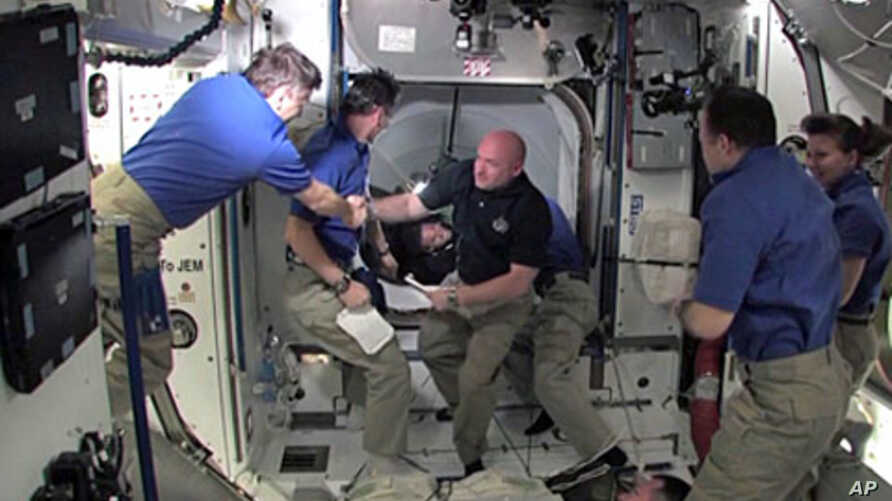 Commander Mark Kelly and the STS-134 crew are welcomed aboard the International Space Station by the Expedition 27 crew, May 18, 2010