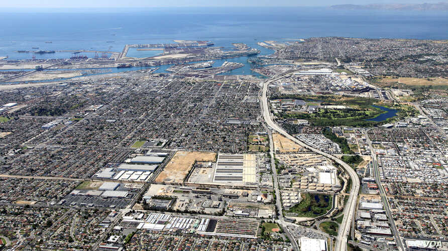 The Los Angeles County Sanitation Districts' Joint Water Pollution Control Plant (center) in Carson, CA, with the Ports of L.A. and Long Beach in the background. The Metropolitan Water District would build a new purification plant on the site.