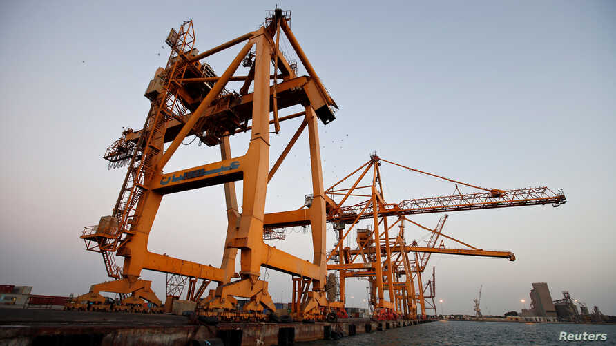 FILE - Cranes, damaged by airstrikes, are seen at the container terminal of the Red Sea port of Hodeidah, Yemen, Nov. 26, 2017.