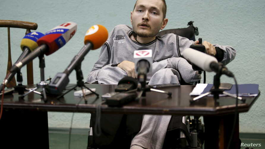 FILE - Valery Spiridonov, who has volunteered to be the first person to undergo a head transplant, attends a news conference in Vladimir, Russia, June 25, 2015.