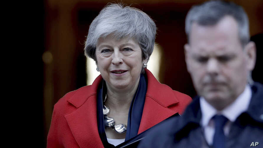 Britain's Prime Minister Theresa May leaves 10 Downing Street to make a statement to the Houses of Parliament in London, Feb. 26, 2019.