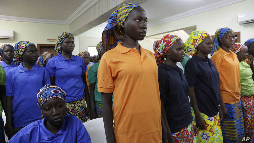 FILE - In this May 8, 2017, photo, Chibok schoolgirls, recently freed from Nigeria extremist captivity, are photographed in Abuja, Nigeria.