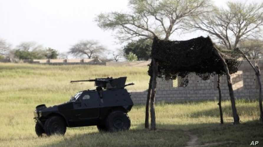An armored vehicle is parked in front of the joint task force headquarters in Maiduguri, Nigeria. (File Photo - September 26, 2011)