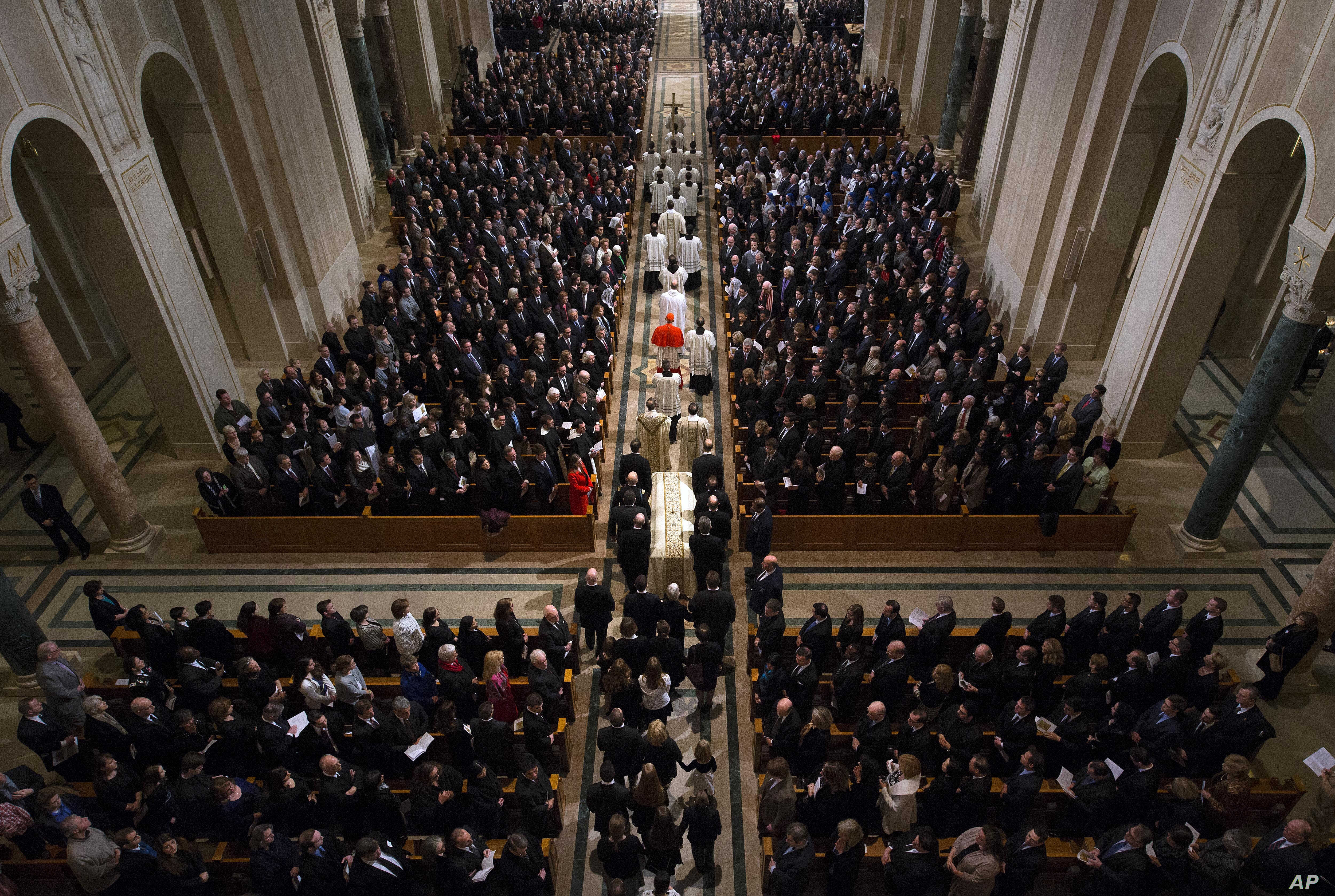 The procession for the funeral mass for the late Supreme Court Associate Justice Antonin Scalia at the Basilica of the National Shrine of the Immaculate Conception in Washington, Feb. 20, 2016.