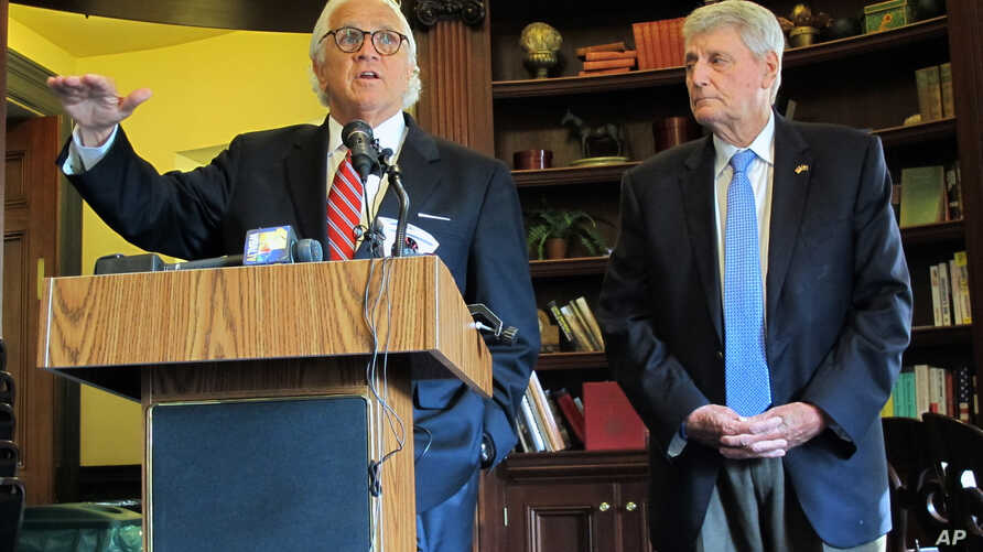 Maryland Senate President Thomas V. Mike Miller, left, and House Speaker Michael Busch discuss an FBI briefing they received about Russian links to a company that maintains part of the state election board's voter registration platform during a news
