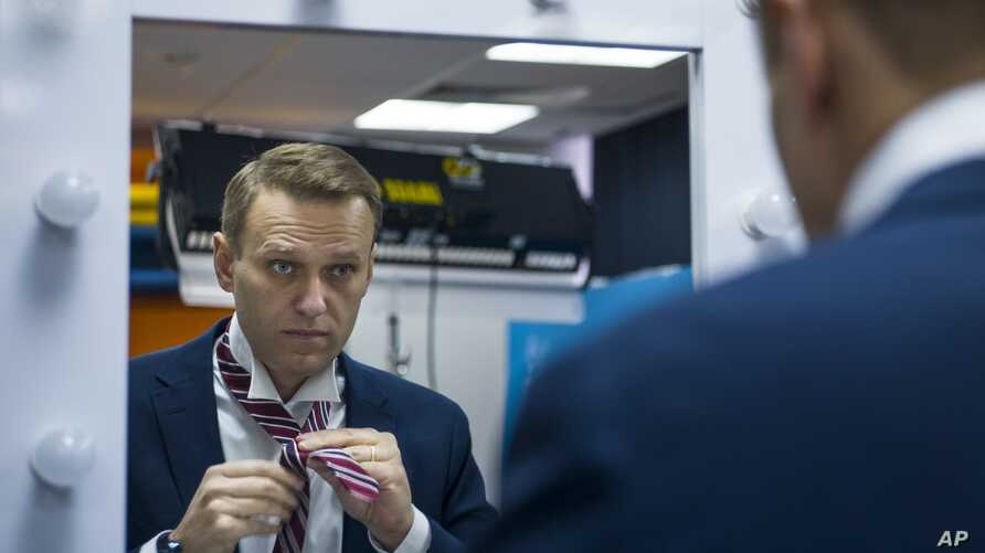 Russian opposition politician Alexei Navalny prepares for his interview with the Associated Press in Moscow, Russia, Dec. 18, 2017.