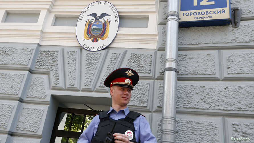 A Russian policeman stands outside the embassy of Ecuador in Moscow, June 24, 2013.