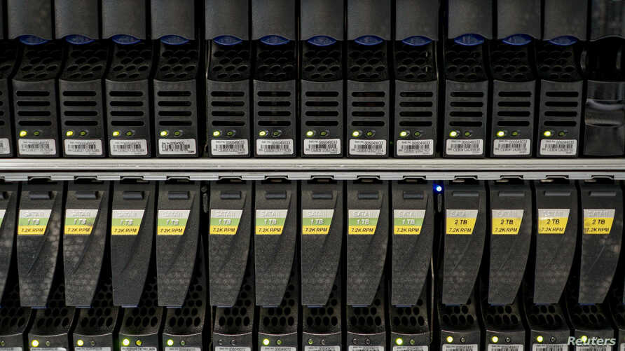 FILE - Hard disks are pictured inside a server room at a company in Bangkok, Thailand, April 5, 2016.