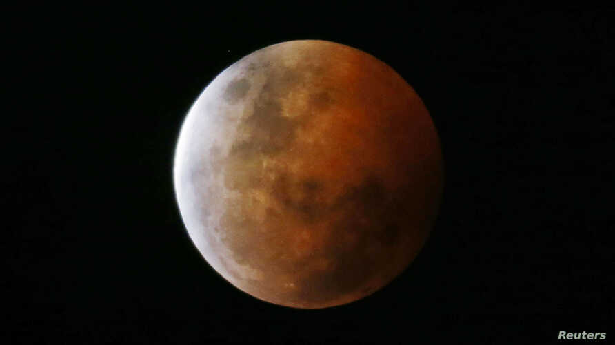 """A total lunar eclipse, also known as a """"blood moon,"""" is pictured from Gosford, north of Sydney, Oct. 8, 2014."""
