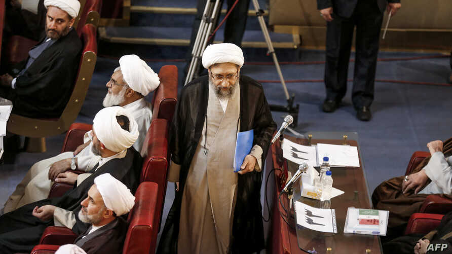 FILE - Iran's judiciary chief, Ayatollah Sadegh Larijani (C), is seen attending a session of the Assembly of Experts in the capital Tehran, March 13, 2018.