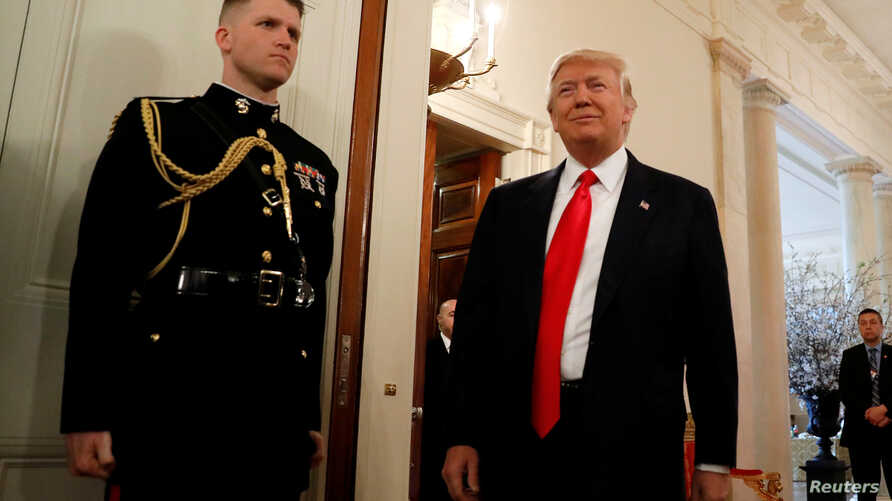 FILE - U.S. President Donald Trump arrives for a National Governors Association meeting at the White House in Washington.