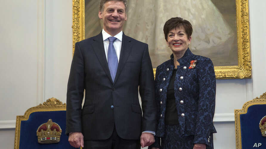 New Zealand Prime Minister Bill English, left, stands with the Governor-General, Dame Patsy Reddy, after being sworn-in at Government House in Wellington, New Zealand, Dec. 12, 2016.