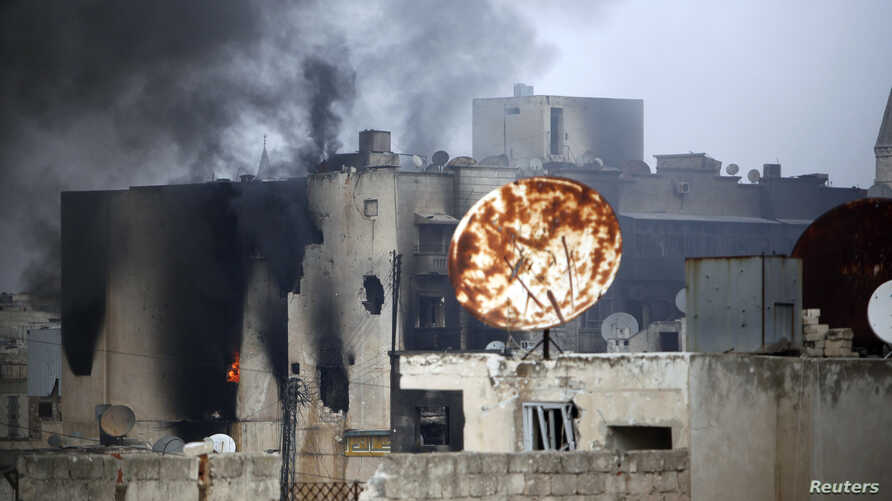 Smoke rises from a damaged building hit by pro-government forces as clashes continue with the Free Syrian Army, near the Old Town of Aleppo, November 2, 2012.