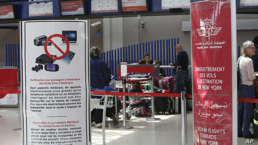 Signs list prohibited carry-on items at the entrance to a Casablanca-New York flight checkpoint at Casablanca Mohammed V International Airport, in Casablanca, Morocco, March 29, 2017.