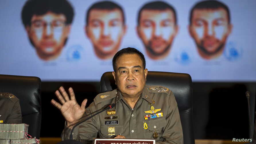Thai national police chief Somyot Pumpanmuang gestures during a news conference about the Bangkok blast which killed 20 people, including foreigners, as a screen shows the different looks of a suspect, who has been referred to both as Bilal Mohammed