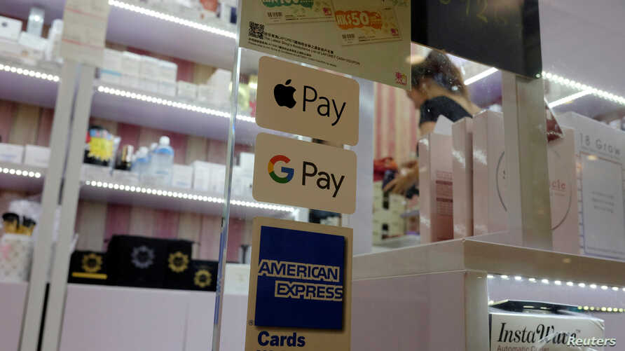 FILE - The Google Pay label is seen affixed to a window in a Hong Kong mall, July 31, 2018.