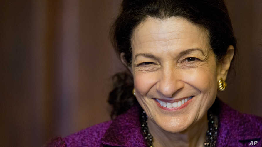 Sen. Olympia Snowe, R-Maine smiles on Capitol Hill in Washington, Thursday, Dec. 13, 2012 after delivering her farewell speech to the Senate.