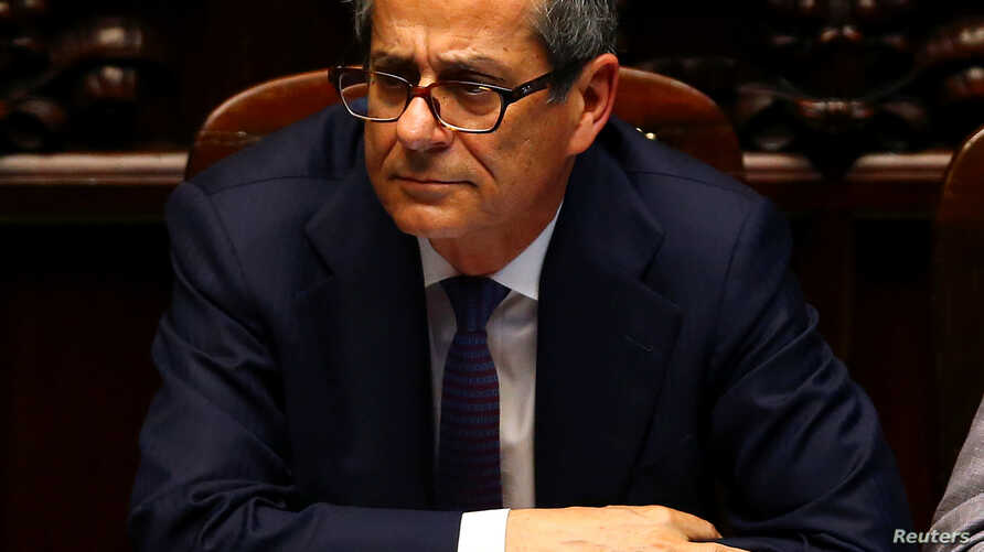 Italian Economy Minister Giovanni Tria attends as Prime Minister Giuseppe Conte (unseen) speaks during his first session at the Lower House of the Parliament in Rome, June 6, 2018.