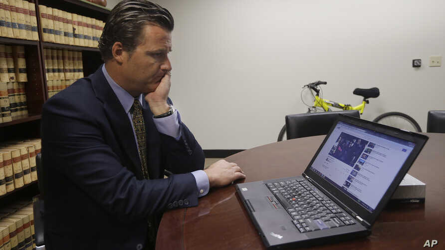 FILE - Robert Allard, an attorney for the family of Audrie Pott, watches a video of Pott at his office in San Jose, Calif., Friday, April 12, 2013. Allard said that Pott committed suicide after she was sexually assaulted by three of her friends and a