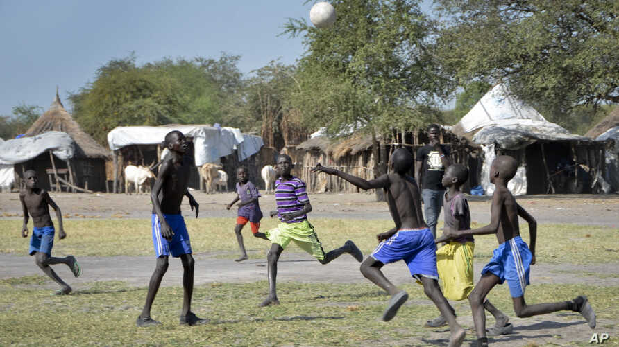 In this photo taken Dec. 8, 2017, boys play a game of soccer in Jiech, Ayod County, South Sudan.