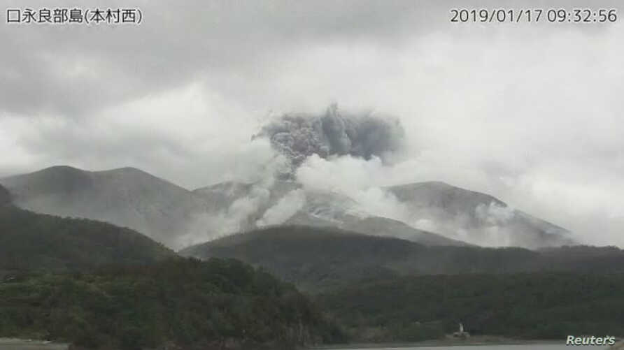 A video grab from the Japan Meteorological Agency's live camera image shows an eruption of Kuchinoerabu Island in Yakushima town, Kagoshima prefecture, southwestern Japan, January 17, 2019.