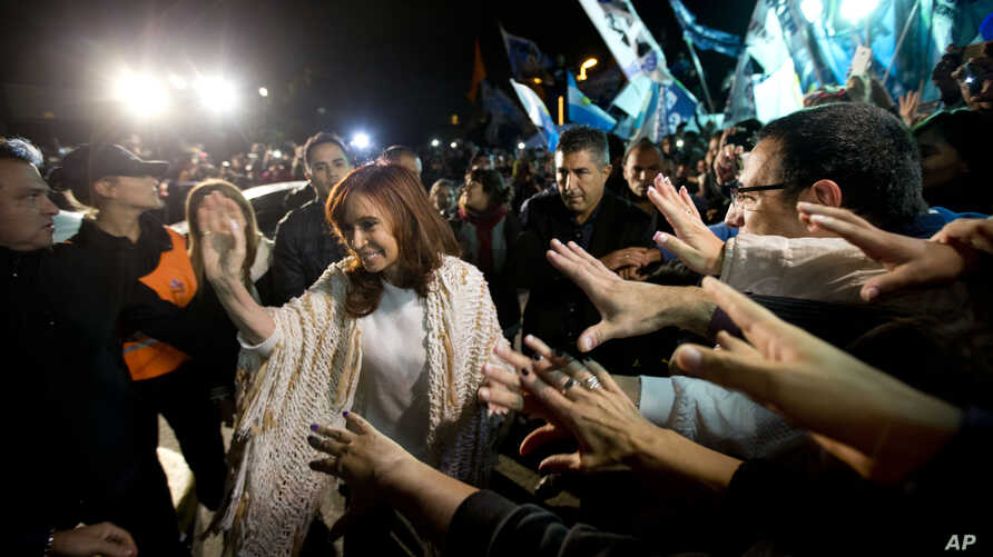 Former Argentina's President Cristina Fernandez, left, is greeted by followers upon her arrival at the airport in Buenos Aires, Argentina, April 11, 2016. After she spent four months in Patagonia, Fernandez' supporters gave her a hero's welcome at a
