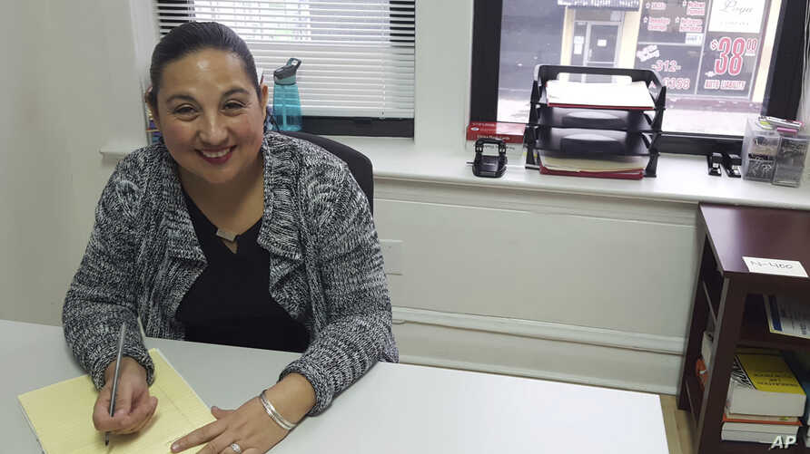 "Esperanza Villalobos, a ""community navigator,"" works at her office at The Resurrection Project in Chicago, Illinois, Dec. 16, 2016. Villalobos helps immigrants who might need legal services to avoid deportation or learn about their legal rights."