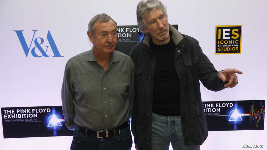 "Band members Nick Mason (L) and Roger Waters pose for photographers at a media event to promote ""The Pink Floyd Exhibition: Their Mortal Remains,"" which will open in May 2017,  in London, Feb. 16, 2017."