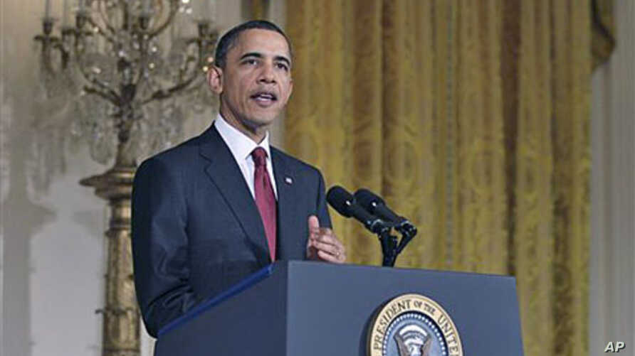 President Barack Obama makes a statement on Libya in the East Room of the White House in Washington, March 18, 2011