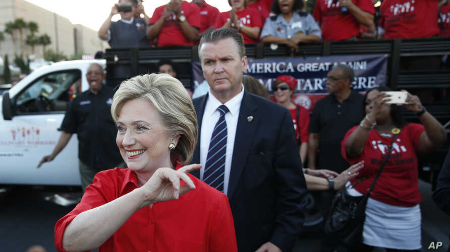 Democratic presidential candidate Hillary Rodham Clinton meets with people during a rally, Oct. 12, 2015, in Las Vegas, held by the Culinary Union to support a union drive at the Trump Hotel.