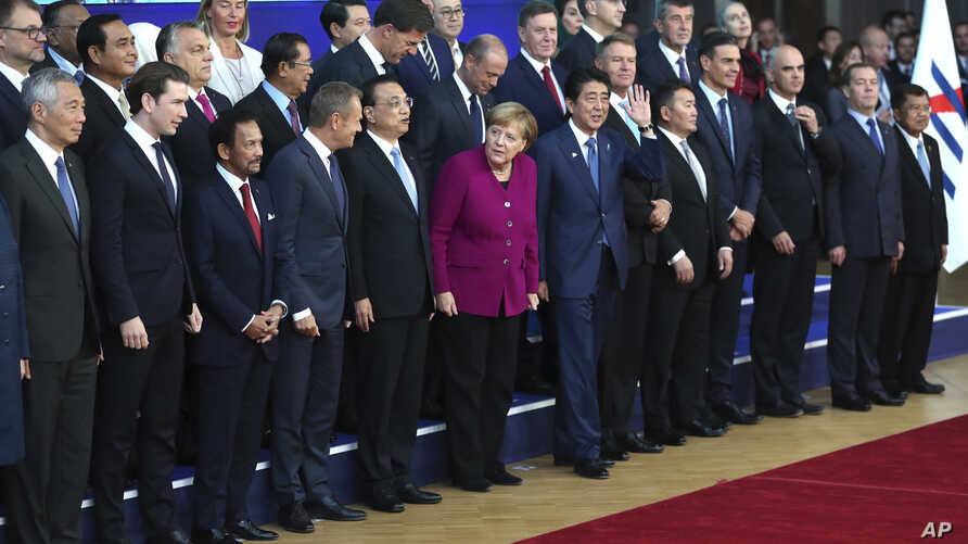 European Union and Asian leaders pose for a group photo during an EU-ASEM summit in Brussels, Oct. 19, 2018.