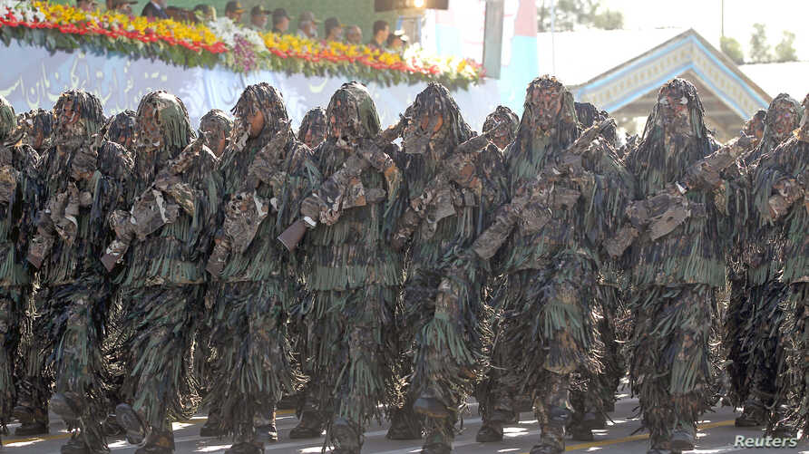 Members of the Iranian Army march during a parade, in Tehran, Sept. 22, 2015.