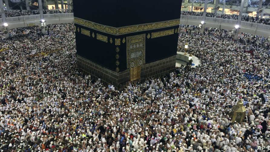FILE - Muslim pilgrims circle the Kaaba, the black cube at center, inside the Grand Mosque during the annual pilgrimage, known as the hajj, in the Muslim holy city of Mecca, Saudi Arabia.