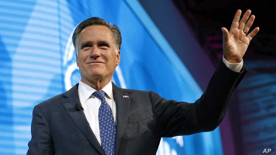FILE - Former Republican presidential candidate Mitt Romney waves after speaking about the tech sector during an industry conference in Salt Lake City, Jan. 19, 2018.
