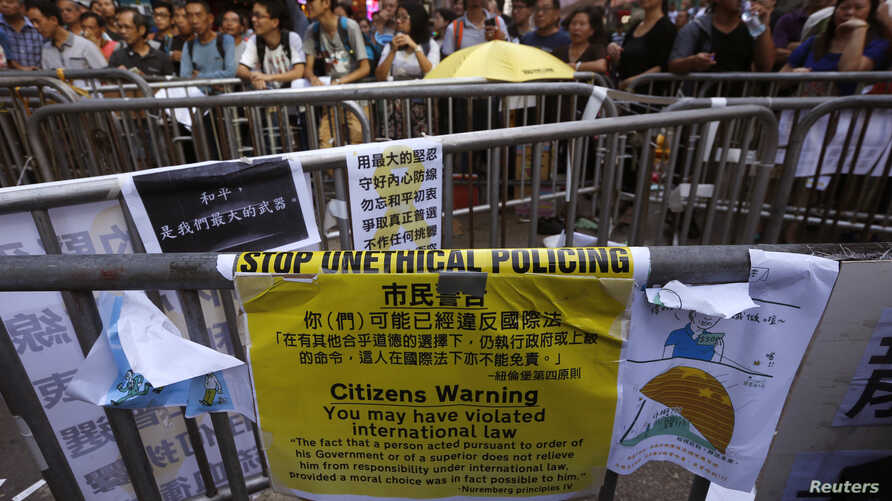 A message left by anti-Occupy protesters is displayed on Nathan Road recaptured by pro-democracy protesters at Mongkok shopping district in Hong Kong, Oct. 20, 2014.