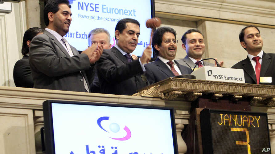 FILE - Ambassador Ali Bin Fahad Al Hajri (center) Qatari Ambassador to the U.S., rings the New York Stock Exchange closing bell, as Qatari Ambassador to the U.N. Nassir Abdulaziz Al-Nasser, gavels the market closed, Jan. 3, 2011. At left is Saif Al M