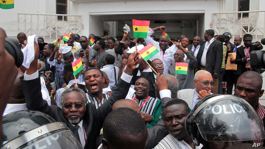 On August 29, 2013, supporters celebrate the supreme court's decision to uphold the results of a presidential election, outside the court in Accra, Ghana. The election of John Mahama was confirmed.
