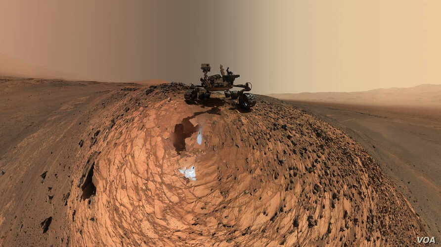 "This low-angle self-portrait of NASA's Curiosity Mars rover shows the vehicle above the ""Buckskin"" rock target, where the mission collected its seventh drilled sample. (Credit: NASA)"