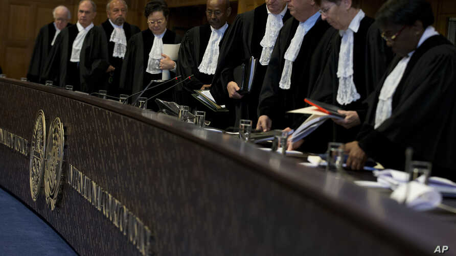 Judges enter the U.N. World Court to deliver their verdict on a request by Bolivia for judges to order Chile to enter talks over granting its landlocked neighbor access to the Pacific Ocean, in The Hague, Netherlands, Oct. 1, 2018.