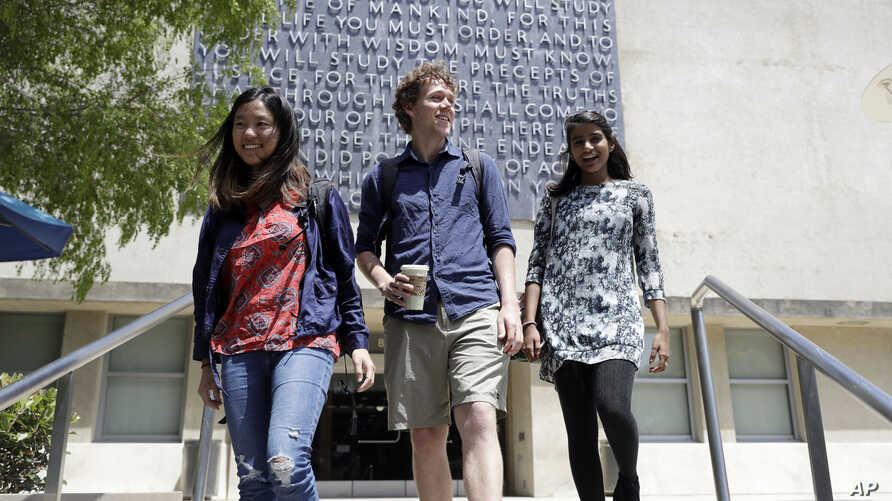 University of California students, from left, Alice Ma,Tyler Heintz and Anjali Banerjee walk near the university's campus, June 6, 2018, in, Berkeley, Calif. The students, who were in Nice, France, when a terrorist drove a truck down a promenade kil