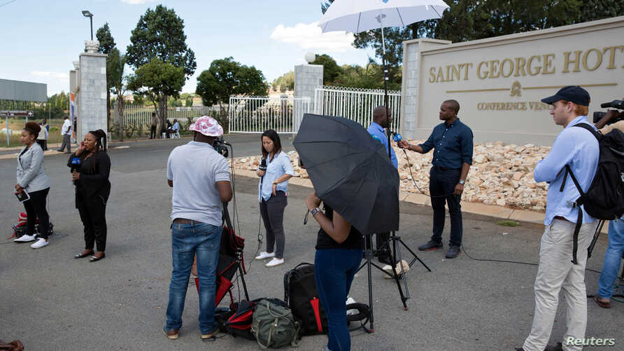 Members of the media gather outside a hotel where members of the African National Congress (ANC) National Executive Committee are meeting to decide the fate of President Jacob Zuma, in Pretoria, South Africa, Feb. 12, 2018.