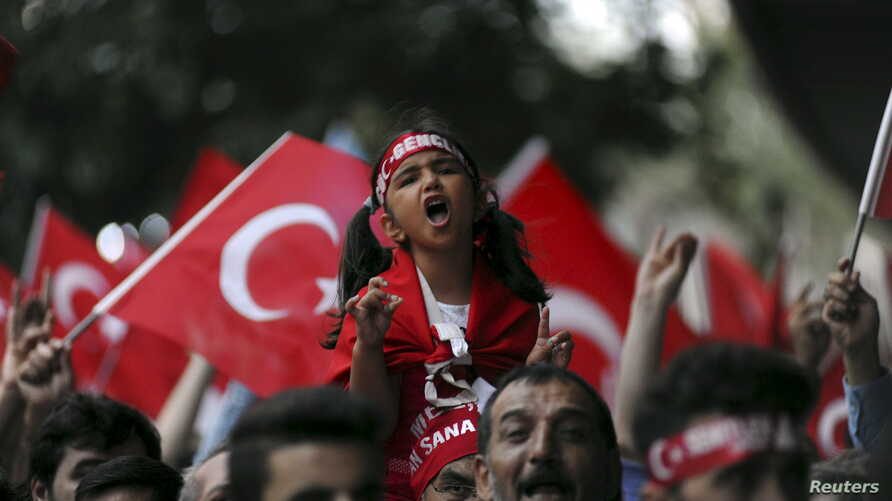 On the same day as a PKK bombing in Igdir province, supporters of ultranationalist groups march with Turkish national flags during a protest against Kurdish militant attacks on Turkish security forces, in Istanbul, Turkey, Sept. 8, 2015.