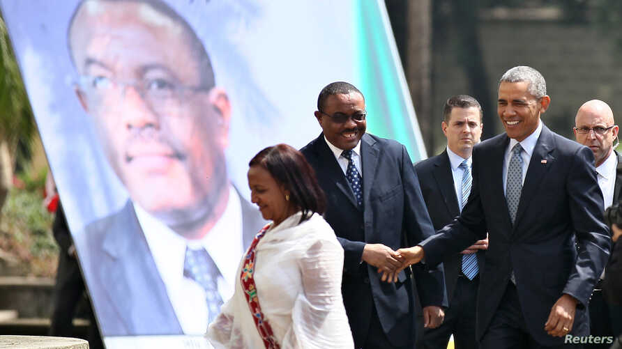 Ethiopia's Prime Minister Hailemariam Desalegn (2nd L) greets U.S. President Barack Obama as he arrives to the National Palace in Addis Ababa, Ethiopia July 27, 2015.