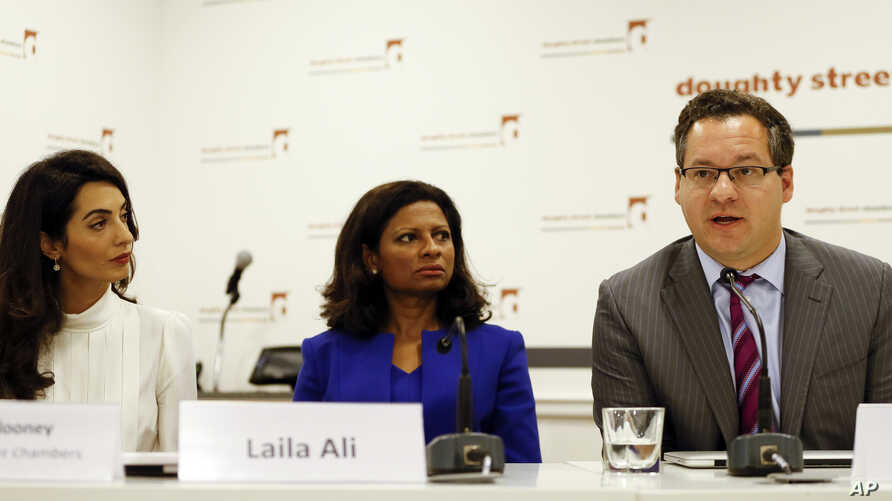 Amal Clooney, left, legal counsel to Mohamed Nasheed, sits with his wife Laila Ali and and Jared Genser of Freedom Now, during a press conference, in London, Oct. 5, 2015.