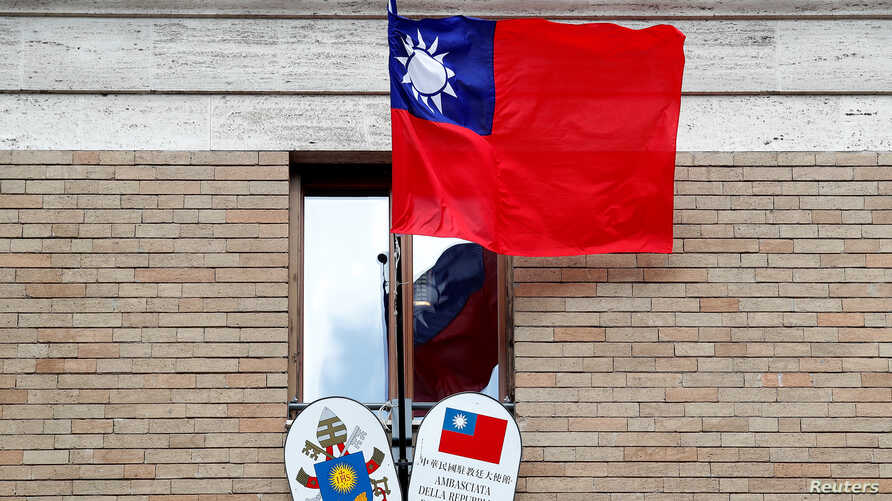 FILE -Taiwan's flag waves outside its Embassy to the Holy See, in Rome, Italy, March 14, 2018.