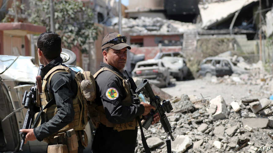 Iraqi Counter-Terrorism Services (CTS) secure a street near the old city in west Mosul on June 3, 2017, during their ongoing battle to retake the city from Islamic State (IS) group fighters.